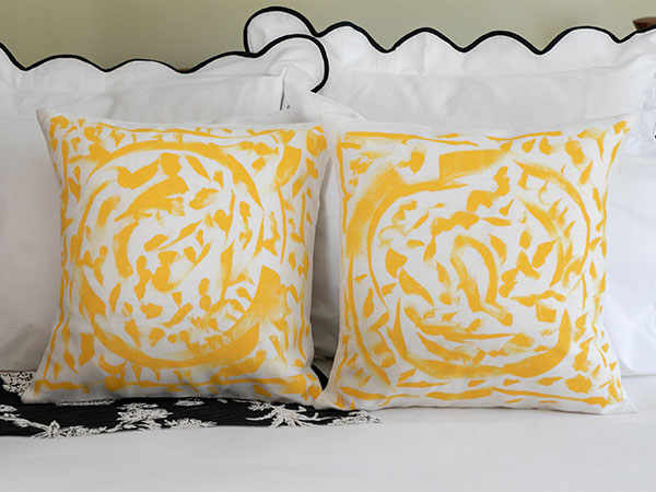 close up of yellow and white patterned pillows