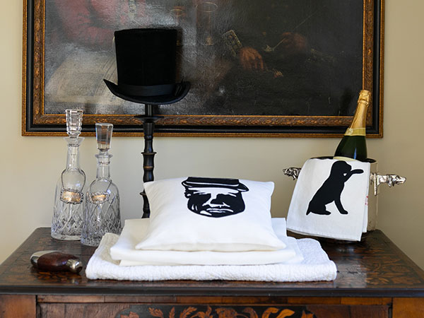 fancy display with silhouette pillow and towels