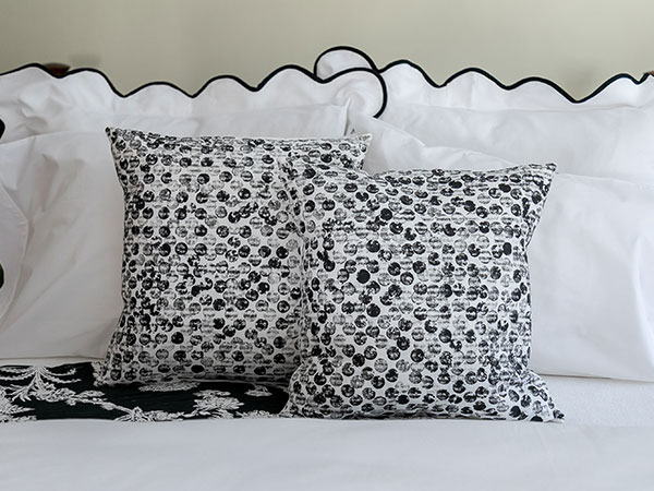 close up of black and white patterned pillows