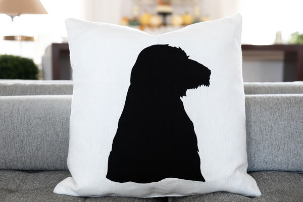 close up of a dog silhouette pillow